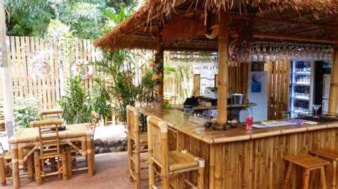 the inviting bamboo bar in the backyard
