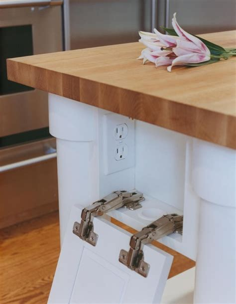 table ls with outlets in base hide your electrical outlets to streamline your kitchen design