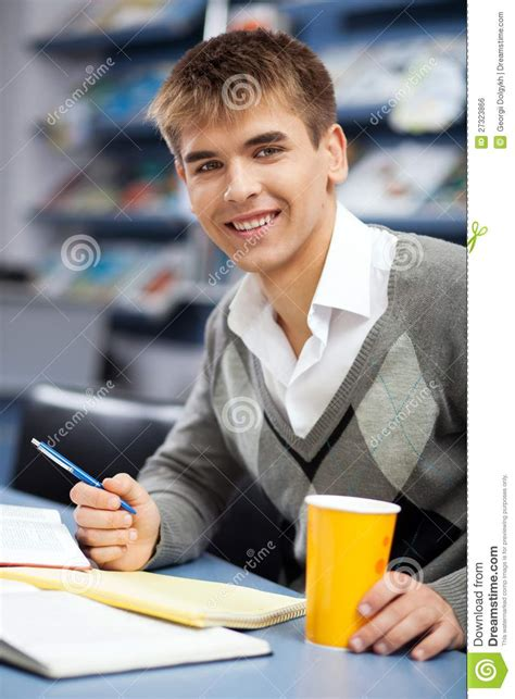 Handsome Male Student In A Library Royalty Free Stock ...