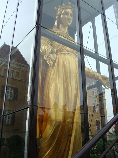 virgin mary golden statue pics