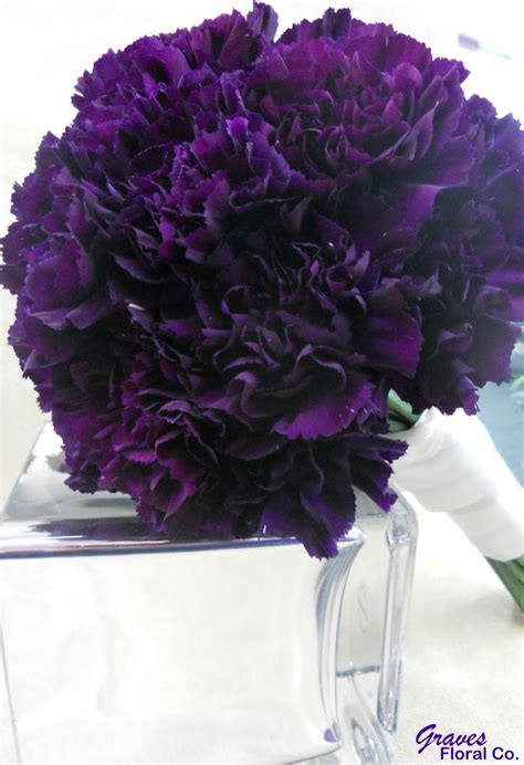 red carnations  black feathers centerpiece bouquet
