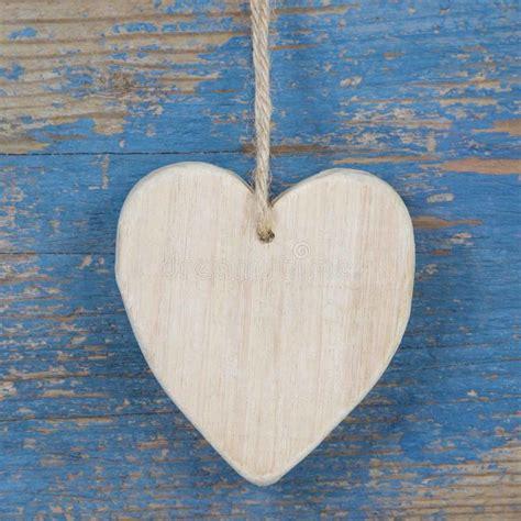 wooden heart shape  blue wooden surface  valentine