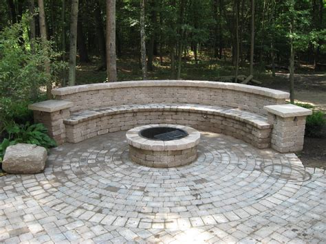backyard brick patio design with seating wall and pit