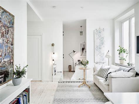 Scandinavian studio apartment with bright white interiors