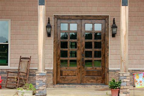 solid wood exterior door with black metal handle and