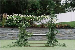 Greenery And White Wedding Arch Minneapolis Wedding