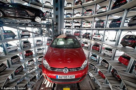 amazing vw germany 600 volkswagens stacked into 200ft silos ready for