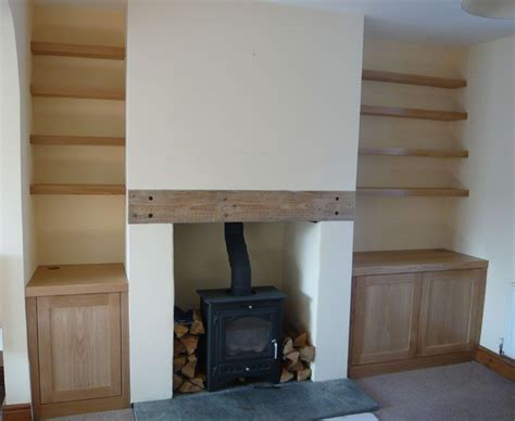 Built In Cupboards Next To Fireplace by Built In Wooden Shelves And Cabinets And A Tv Instead Of