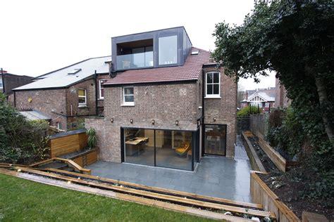 Dormer Roof Extension by Slim Framed Sliding Doors To Residential Refurbishment