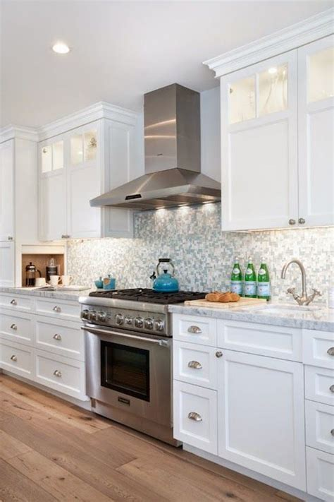 white  blue kitchen features white cabinets adorned