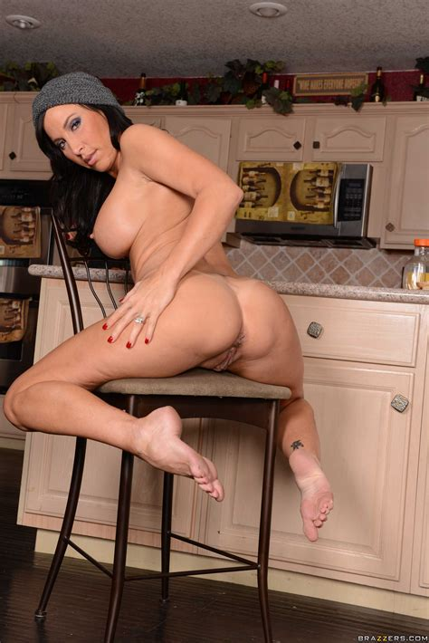 Busty Brunette Is Masturbating In The Kitchen Photos