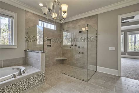 master bathroom with high ceiling drop in bathtub in