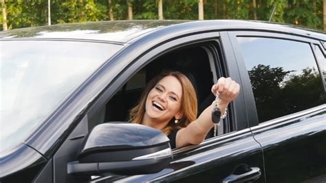 Woman Driver Holding Car Keys Driving Her New Car By