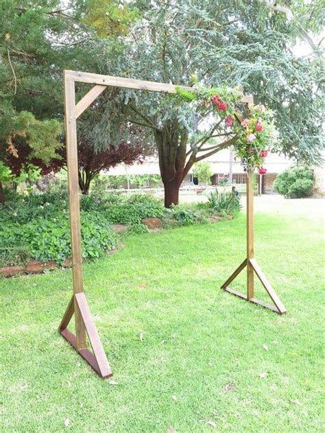 handcrafted timber wedding arch wedding ceremony ideas