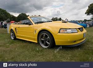 ford mustang 2000 convertible soft top tops yellow Stock Photo: 50170996 - Alamy
