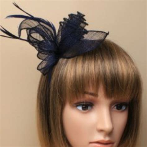 navy blue fascinator  sinamay flower  feather