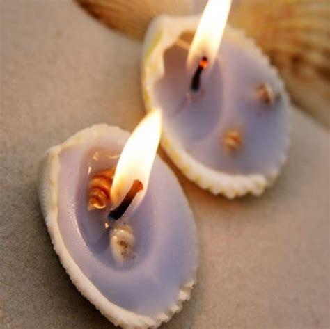 realiza unas velas decorativas  conchas de caracoles
