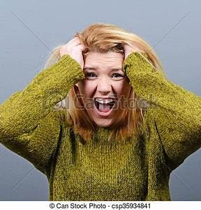 Stock Photo Of Portrait Of A Histerical Woman Pulling Hair