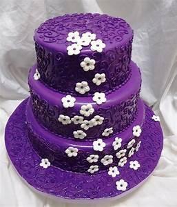 Purple Wedding Cake With White Flowers