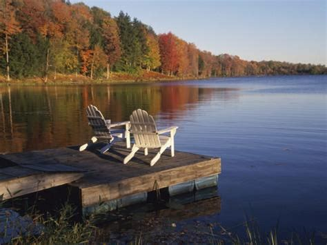 adirondack chairs on dock at lake photographic print by