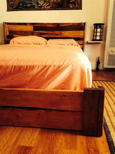 hand  reclaimed rustic bed frame  floating