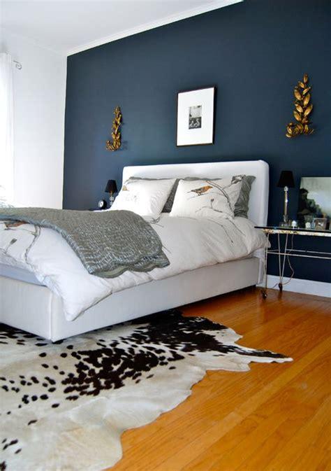 dark blue wall  white bed  wooden floor home bedroom blue accent walls bedroom colors
