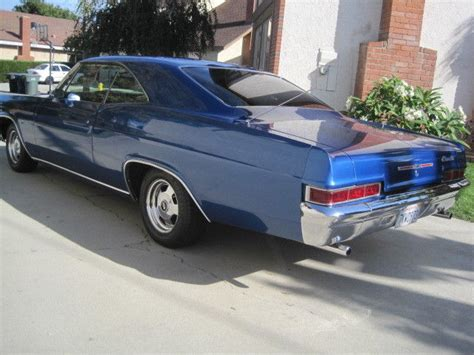 1966 chevrolet 2 door impala coupe in chevrolet quot metallic danube blue quot paint