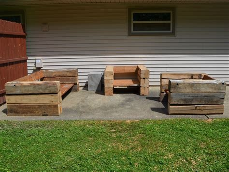 handmade outdoor chairs and sofa made from reclaimed barn