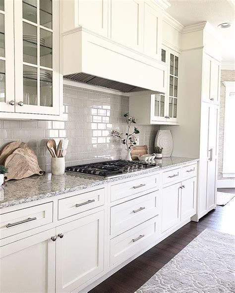 white cream kitchen cabinets white subway tile backsplash