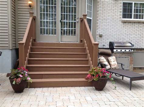 paver patio with pit seating wall and grill trex steps