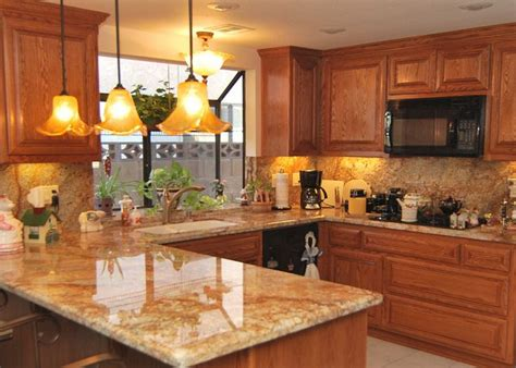 honey oak kitchen cabinets with granite countertops granite to match oak cabinets brown painted kitchen