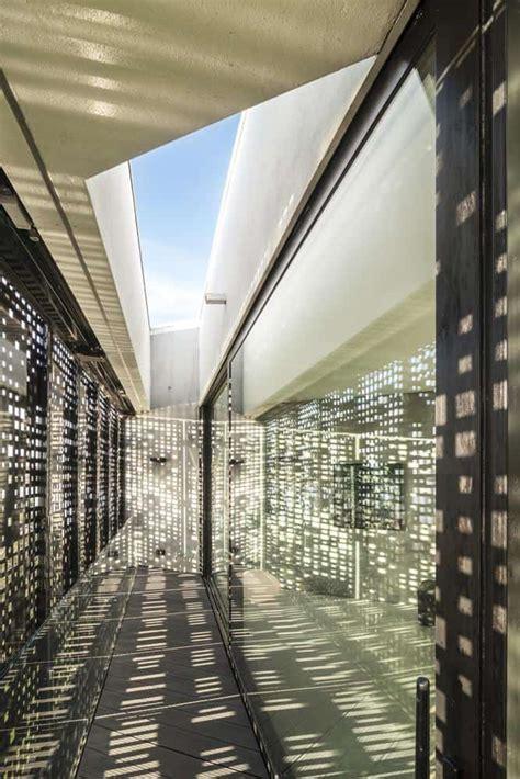 diamond shaped house  curving glass windows modern