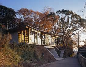 stunning homes built into hillside japanese residence with wood and glass geometry