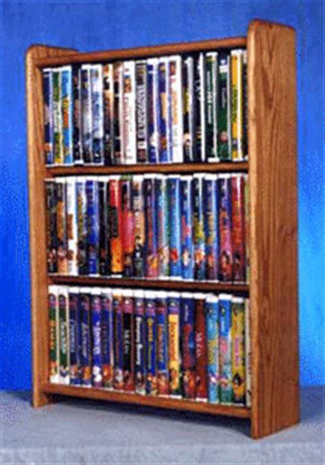 solid oak cabinet  dvds vhs tapes books