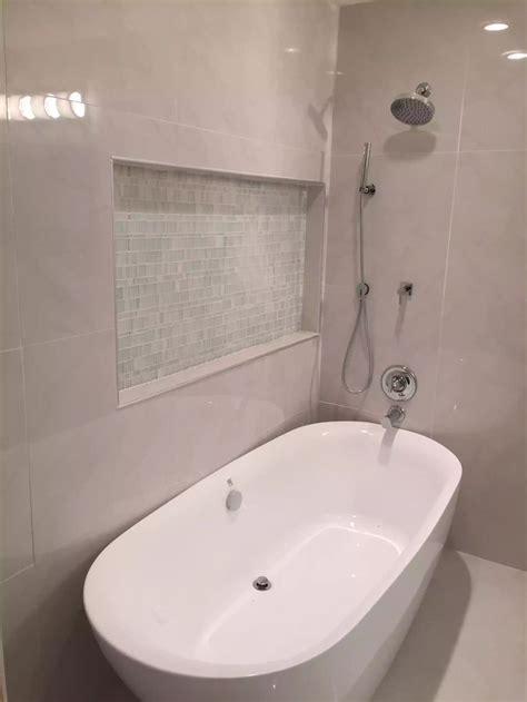 white porcelain tile freestanding tub  shower combo