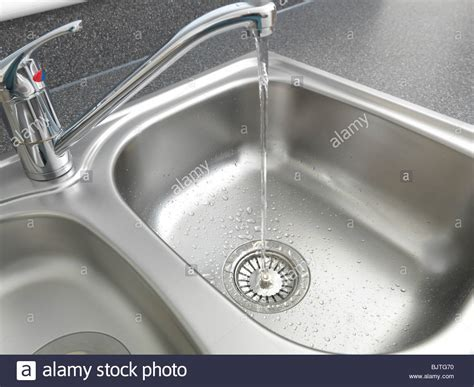 Water Running From Tap Into Kitchen Sink Basket Strainer