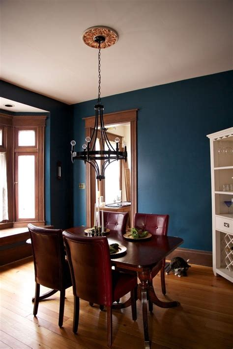 turquoise wall color  wood trim dining space ideas