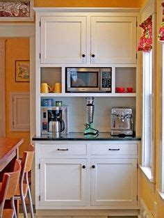 how to clean wood cabinets in the kitchen a kitchen with world charm meets modern amenities 9719