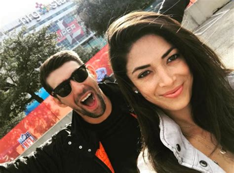 Michael Phelps & Nicole Johnson From Celebs At Super Bowl