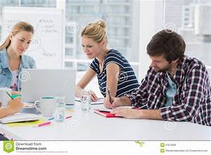 Casual Business People Around Conference Table In Office ...