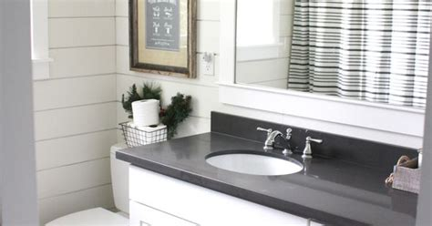 simple farmhouse christmas bathroom  shiplap quartz countertops white shaker cabinets