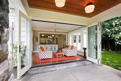 Inside Outside Living Room Ideas by Doors Open To Back Porch On H H Home Remodel Doors