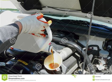 Adding Oil To A Car Stock Photography