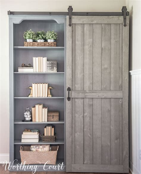 sliding barn door bookcase bookcase makeover traditional cherry to farmhouse fab