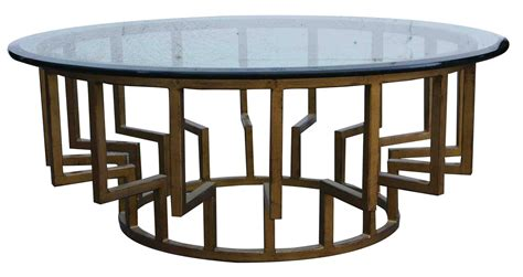 Round glass coffee table metal base for the contemporary home where metal and glass are common, a round glass coffee table with a metal base will fit perfectly into the modern decorative architecture. 30 Best Round Glass and Wood Coffee Tables