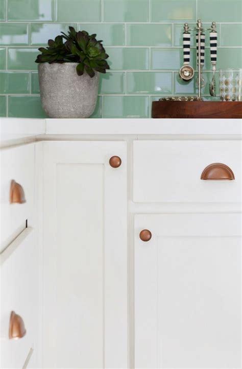 mint green glass tile backsplash  copper hardware