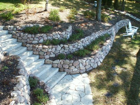 terraced retaining wall retaining walls and outcroppings treetops landscape