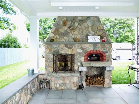 A Wood Fired Brick Oven On A Covered Patio In A New Brom
