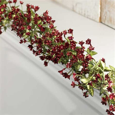 red sparkling artificial christmas garland christmas
