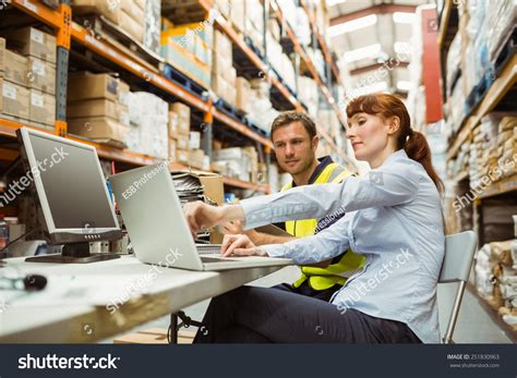 Warehouse Worker Manager Looking Laptop Large Stock Photo